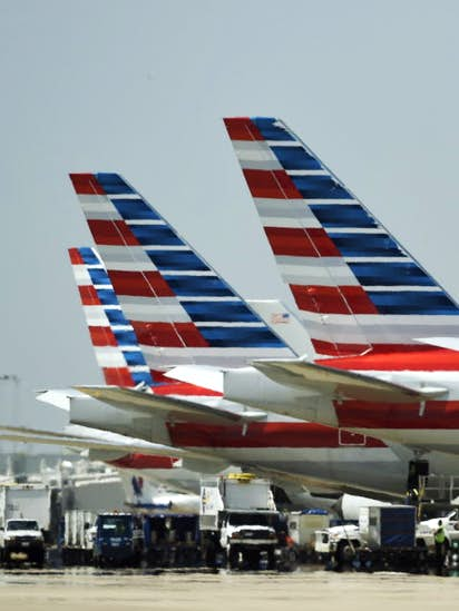 man arrested after jumping fence and boarding american airlines