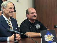 Gov. Greg Abbott, with Chris Dyer, president of the Dallas County Sheriff's Association, received the endorsement of the group for his re-election during a news conference in Dallas on Thursday.(David Tarrant/Staff)