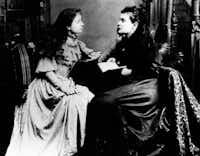 """Helen Keller (left) """"hears"""" Anne Sullivan by feeling the vibrations on her lips.(/AP)"""