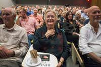 Cheryl King, the mother of Michael Meredith, center, watches herself in a preview of Meredith's film during Duets Conversation Series.(Carly Geraci/Staff Photographer)