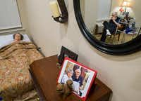 "<p>A recent photo is displayed on a dresser as Bob Stiegler sits with his wife, Norma, at <span style=""font-size: 1em; background-color: transparent;"">Silverado Plano Memory Care Community.</span></p>(Ashley Landis/Staff Photographer)"