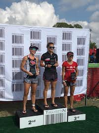 Brandi Grissom Swicegood at the podium of Jake's Generic Triathlon in Austin. Swicegood placed second, with her teammate, Haley Koop, who won the race, and third-place finisher, Missy Ruthven. (Brandi Grissom Swicegood)