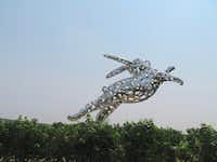 A 35-foot-long, stainless-steel leaping rabbit by artist Lawrence Argent greets visitors as they enter the Hall Wines  showcase winery in St. Helena, Calif. It is one of 38 pieces of art on the property.(Sheryl Jean/Special Contributor)
