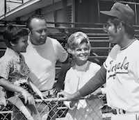 Bob Stiegler, his wife, Norma, and their son Greg chat with Lou Piniella of the Kansas City Royals in Florida during spring training in 1972. Bob was a salesman for the Royals.(Provided by Greg Stiegler)