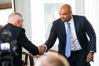 Congressional candidates Colin Allred and Pete Sessions shake hands before a debate at a Rotary Club of Dallas lunch on Wednesday, September 19, 2018 at The City Club in downtown Dallas. (Ashley Landis/The Dallas Morning News(Ashley Landis/Staff Photographer)