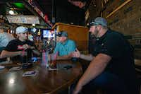 Jimmy Sullivan (left) meets with Mike Titus (center) and Matthew Eleazer at a pub in Portland, Ore. Eleazer and Titus, union officials, offered to find Sullivan a job if he could pass a drug test.(Heidi de Marco/Kaiser Health News)