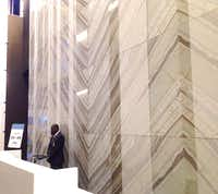<br>(Steve Brown/Quartzite stone panels from Brazil line the walls of the Crow Center's revamped lobby.)