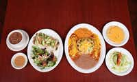 <p></p><p>A spread by Ojeda's at 4617 Maple Ave. in Dallas. On the left is Naked Mushroom Enchiladas with sliced avocado, pico de gallo, salad and beans. On the right, Ojeda's Dinner - small guacamole salad, chile con queso on tostada, two beef enchiladas, 1 puffed taco, rice and refried beans.</p><p></p>(Mei-Chun Jau/Special Contributor)