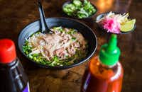 Make easy beef pho at home with broth, sliced meat and garnishes.(Carly Geraci/Staff Photographer)