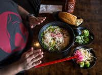 Owner Khanh Nguyen of Dalat Restaurant talks about what ingredients you can use to make pho at home.(Carly Geraci/Staff Photographer)