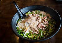 Owner Khanh Nguyen of Dalat Restaurant shows what ingredients you can use to make pho at home.(Carly Geraci/Staff Photographer)