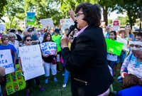 "Former Dallas sheriff and Democratic candidate for governor Lupe Valdez, right, speaks as protesters show opposition to the family separation policy enforced on immigrants at the U.S./Mexico border on Wednesday, June 20, 2018, outside the Dallas office of U.S. Rep. Pete Sessions. The event was named the ""Dallas Keep Families Together Demonstration."" (Ashley Landis/Staff Photographer)"