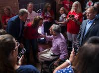 Texas Gov. Greg Abbott greets Attorney General Ken Paxton and his wife Angela Paxton before speaking at a Collin County Republican Party event Monday, September, 3, 2018, in McKinney.(Ryan Michalesko/Staff Photographer)