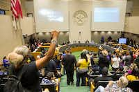 "<p>Protesters raised their fists and yelled ""no justice, no peace"" during a City Council meeting Sept. 12, 2018, at Dallas City Hall.</p>(Shaban Athuman/Staff Photographer)"