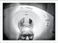 12/13/16 — PET scanner. 30 minutes on my back moving to and fro in that massive machine with my arms above my head. Had a terrible headache at the start and kept falling asleep during the scan. They had to wake me when it was over and the headache was gone. Karma.(Guy Reynolds/Staff Photographer)