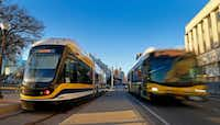 A DART bus passes by the Dallas Streetcar at the Reunion Station stop in Dallas, Tuesday, Jan. 23, 2018. (Jae S. Lee/Staff Photographer)