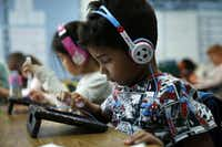 First grader Aiden Diaz works on an iPad at Frisco ISD's Bright Academy in Frisco Thursday. (Rose Baca/The Dallas Morning News)