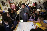 Josh Melton, AP literature teacher, talks with his students during class at Frisco ISD's Liberty High School on Thursday, (Rose Baca/The Dallas Morning News)