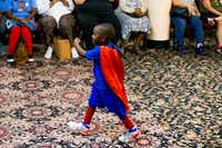 """""""President"""" Austin Perine, 4, walks to the kitchen to serve food to the homeless at Dallas LIFE shelter in downtown Dallas.(Shaban Athuman/Staff Photographer)"""