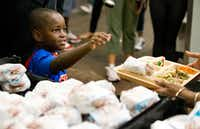 Austin Perine, 4, stopped in Dallas as part of his cross-country tour to help feed and raise awareness for the homeless. (Shaban Athuman/Staff Photographer)