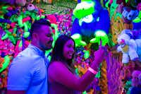 Karen Nino takes a selfie with Brian Rosas at the <i>Sweet Tooth Hotel</i> art installation in July(Ashley Landis/Staff Photographer)