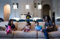Naveed Khan cooks lunch for his wife, Ayesha, and children, Nazneen, 7, Yasmeen, 4, and Rehan, 1, in their home in Southlake.(Shelby Knowles)