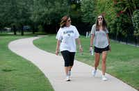 Amy Hardesty walks with Annika Rains near Fisher Elementary School in Frisco on Aug. 29. Hardesty and Rains both taught at Truman Primary School in Norman, Okla., last year. Rains has moved to Little Elm to teach at Vaughn Elementary School in Frisco. Hardesty commutes from Norman on the weekends.(Vernon Bryant/Staff Photographer)