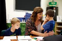 Grayson Kubala (left), waits for kindergarten teacher Amy Hardesty as she talks with Oliver Turkawski during class at Fisher Elementary School in Frisco on Sept. 4.(Vernon Bryant/Staff Photographer)