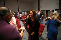 Amy Hardesty greets Marin Cebalo of Norman during a greeting period at Norman Community Church of the Nazarene in Norman, Okla., on Sept. 16. (Vernon Bryant/Staff Photographer)