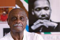 The Rev. Peter Johnson of Dallas in front of a poster of the Rev. Martin Luther King Jr., his former boss. Johnson, known as Dallas' dean of civil rights, is the founder of the Institute for Non-Violence. He wants an outside investigation of the DeSoto police Department.(File Photo/Staff)