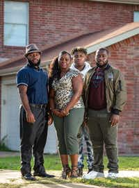 Sammie Anderson (second from left) poses with her sons Sam Bible, 18 (left), Ty Anderson, 15 (third from left), and Grant Bible, 20, at their home in DeSoto.(Brandon Wade/Special Contributor)