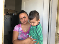 El Paso resident Maribel Chavez, 28, holds her 1 -year-old son, Lean, in the Segundo Barrio neighborhood. She laments she will soon lose her home's view into Juarez because of the construction of an 18-foot high bollard fence that's federal authorities refer to as a 'wall.'(Alfredo Corchado/Staff Photographer<br>)