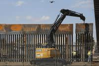 "Workers in El Paso replace a section of the border fence next to the international border bridge ""Paso del Norte"" as seen from Ciudad Juarez, in Chihuahua state, Mexico, on Sept. 26, 2018. (HERIKA MARTINEZ/AFP/Getty Images)"