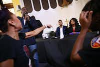 Melissa Perry (far left) shouts at Dallas County District Attorney Faith Johnson, who is seated next to Dallas attorney Justin Moore, regarding a question about Amber Guyger's charge, during a town hall panel regarding action taken following the death of Botham Jean, who was shot and killed by fired Dallas police officer Amber Guyger, at St. Paul United Methodist Church in Dallas on Saturday, Sept. 29, 2018. (Rose Baca/The Dallas Morning News)(Rose Baca/Staff Photographer)