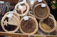 Oma's Choice from Schulenburg has a huge presence at the Go Texan General Store at the State Fair, from pickled quail eggs and churro nuggets to these inspired single-serving pies, including the blueberry-and-cherry Texas pie, apple, pecan, pumpkin and coconut-pecan.(Kim Pierce/Special Contributor)