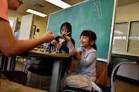 First-grader Layla Puente reacts with a smile as she shows off her creation to tutor Christian Hernandez during a building activity at the Trinity River Mission after school program in West Dallas, Monday, Sept. 10, 2018.(Ben Torres/Special Contributor)