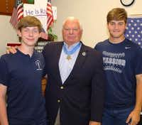 Medal of Honor recipient Lt. Michael E. Thornton, with Liberty Christian  students Henry Harshfield (left) and Brayden Dragoo in 2016, will speak at the Friends of Freedom dinner.(Liberty Christian School)