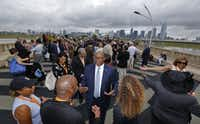 Ambassador Ron Kirk is greeted  before the dedication ceremony for the Ronald Kirk Pedestrian Bridge in Dallas on June 4, 2016.  (Nathan Hunsinger/Staff Photographer)