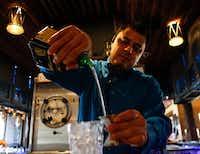 Head bartender Odie Martinez pours orange liqueur while making The Mariano margarita at Mariano's Hacienda.(Brian Elledge/Staff Photographer)