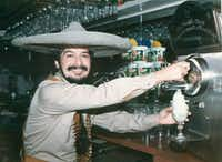 Mariano Martinez in 1991 with his frozen margarita machine at Mariano's in Old Town. (Mariano Martinez)