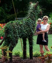 <p>Three-year-old Alex Gorischek and his  mother, Susan, look at a zebra topiary at the Dallas Arboretum in 1997.&nbsp; (Staff Photo)</p>