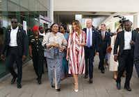 First lady Melania Trump and Ghana's first lady Rebecca Akufo-Addo walk to their vehicles as they leave Greater Accra Regional Hospital in Accra, Ghana, on Oct. 2, 2018. Trump is visiting Africa on her first big solo international trip, aiming to make child well-being the focus of a five-day, four-country tour. (Carolyn Kaster/The Associated Press)