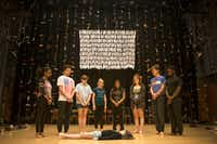 Maren Bennett, 10, is surrounded in Cry Havoc Theater Company's <i>Babel</i>, an original show about gun violence that the company presented in July at the Winspear Opera House.(Carly Geraci/Staff Photographer)