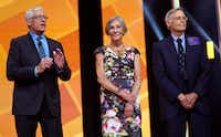 Alice Walton (center) shares the stage at Walmart's annual meeting in June with brothers Rob (left) and Jim. The Waltons rank among the nation's wealthiest people.(Rick T. Wilking/Getty Images)