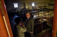 Kimberly Bizor Tolbert, chief of staff to the City Manager for the City of Dallas, spoke with with Majed Al-Ghafry, assistant city manager, during their tour of the empty Dawson State Jail in March 2017.(Ben Torres/Special Contributor)