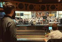 "<p><span style=""font-size: 1em; background-color: transparent;"">Dallas native composer Daniel Hart in 2016 recording his score for 'Pete's Dragon' at AIR studios in London. The film was directed by Dallas' David Lowery. Hart teamed up with Lowery again to score 2018's 'The Old Man and the Gun' with Robert Redford.</span></p>(Rachel Ballard/Rachel Ballard)"