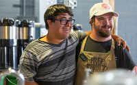 Spencer Khan (left) and William Mullican speak to costumers as the workday ends at Empowerment Coffee in downtown Austin, on Wednesday, Aug. 1, 2018. Empowerment Coffee opened in March, employing individuals with intellectual or developmental disabilities. (Stephen Spillman/The Associated Press)