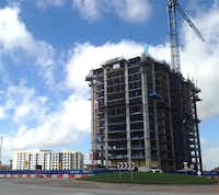 An apartment tower and two hotels are still under construction n Frisco Station.(Steve Brown)
