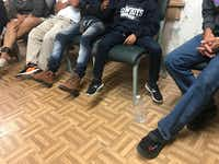 Families at Annunciation House on Sunday recounted their time in holding cells in the El Paso region. All asked that their faces not be shown, but gave permission to show their feet, most of them with ankle monitors.(Alfredo Corchado/The Dallas Morning News)
