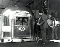 <p>Apollo 11 astronauts Neil Armstrong (from left), Michael Collins and Buzz Aldrin Jr., inside the mobile quarantine facility aboard the USS Hornet, listened to President Richard Nixon as he welcomed them back from their moon voyage on July 24, 1969.</p>(NASA/)